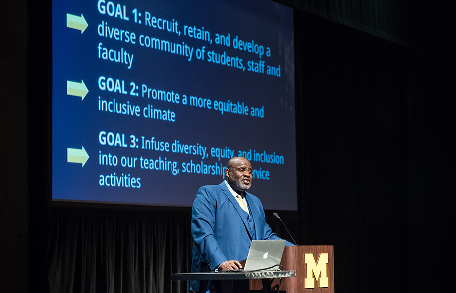 Photo of Robert Sellers outlining DEI progress with slide showing goals