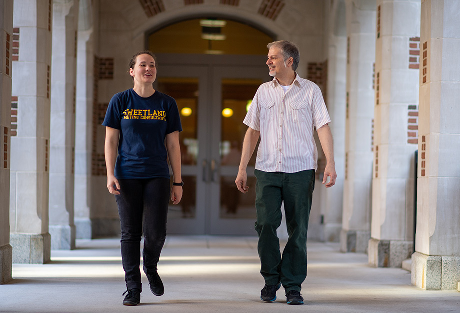 Photo fo student Anna Horton walking with LSA lecturer Louis Cicciarelli