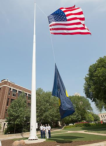 Restored flagpole for central campus dedicated the university record above members from u ms rotc programs raise the us and u m flags as part of a ceremony monday to dedicate the restored flagpole on the north end of the sciox Image collections