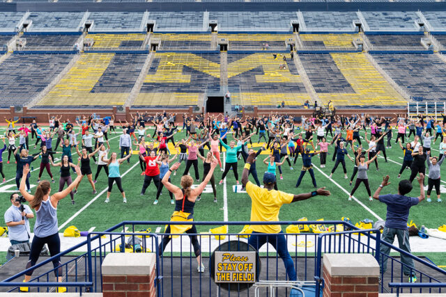 "Photo of faculty and staff at last year's ""Be Well in the Big House"" at Michigan Stadium."