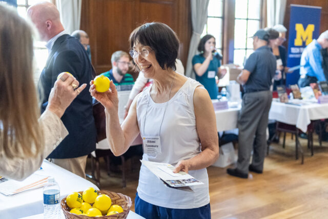 "Photo of Hitomi Tonomura, professor of history and women's studies, holding a complimentary ""stress ball."""