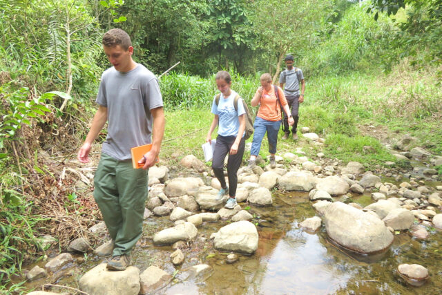 A student team from the Center for Socially Engaged Design hikes to a village in Ecuador.