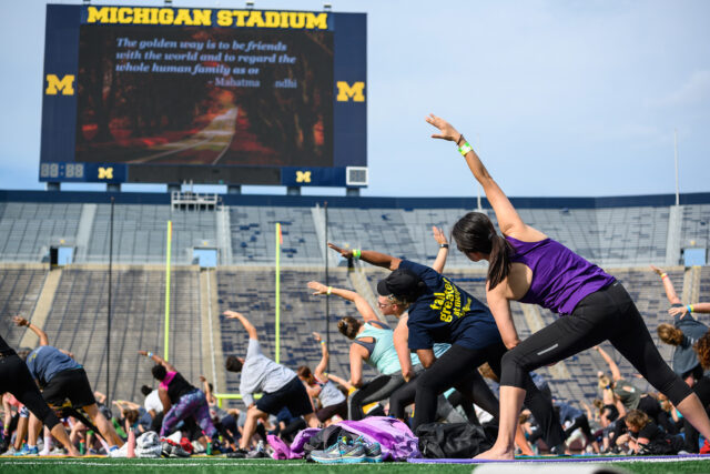 Yoga class on the Michigan Stadium field during Be Well in the Big House.