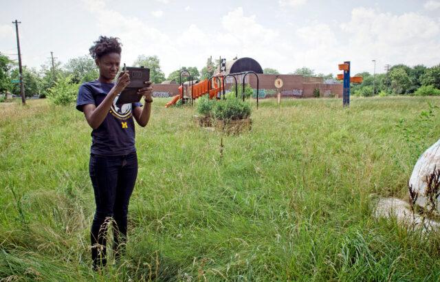 Former U-M student Jasmine Omeke photographs footpaths across an abandoned school yard in Detroit in 2013.