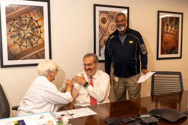 Photo of President Mark Schlissel receiving a flu shot.