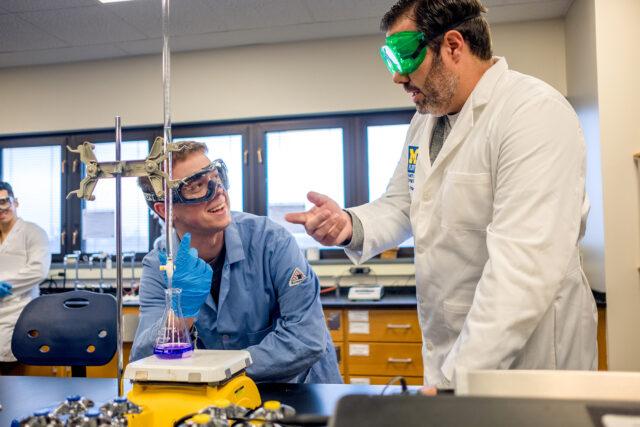 Nicholas Wills, a senior majoring in Green Chemistry at UM-Flint, works alongside Nicholas Kingsley, associate professor of inorganic chemistry.