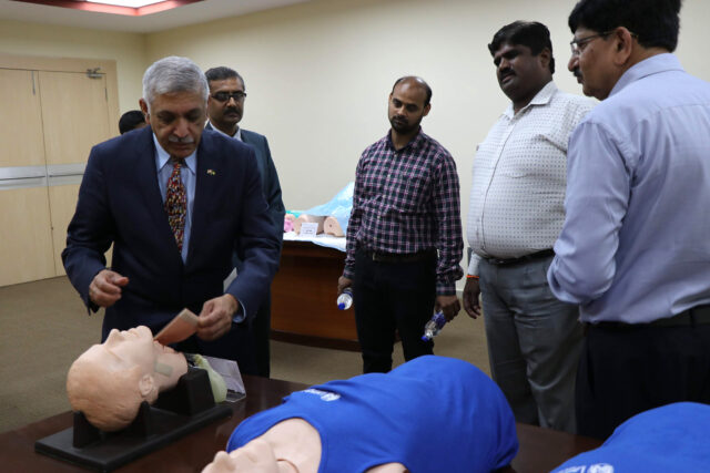 Krishnan Raghvendran, U-M professor of surgery, demonstrates a procedure to advanced emergency medical technicians in India.
