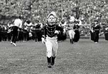 Kindergartner leads the Michigan Marching Band in 1949