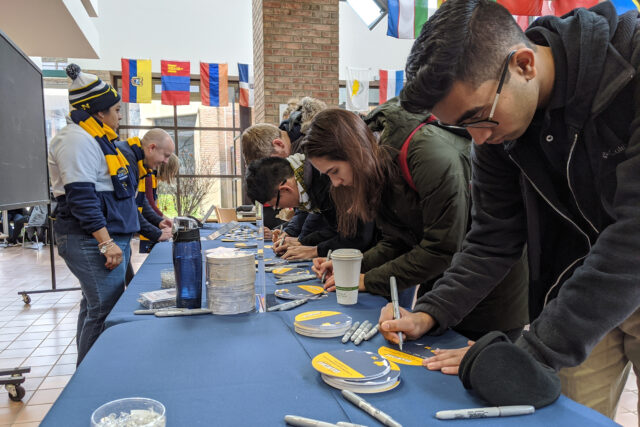 Photo of students at Pierpont Commons on the Ann Arbor campus nominating causes and organizations to receive donations on Giving Blueday.