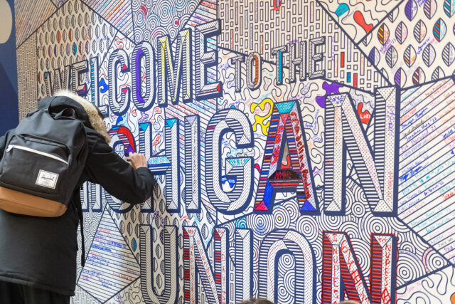 Visitors to the Michigan Union's reopening ceremony were invited to color a mural welcoming people to the new facility. The university's iconic central building underwent a 20-month, $85.2 million renovation, which was celebrated with a ceremony and tours Jan.13. (Photo by Daryl Marshke, Michigan Photography)