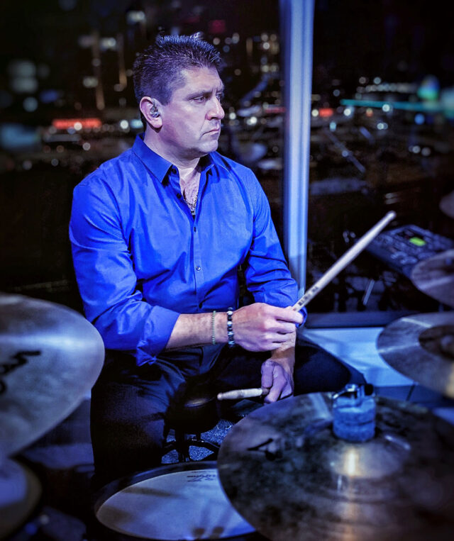 """Theo Chalogianis, the first lead police officer embedded in the Michigan Medicine community, plays drums in a Greek band called Oneiro, which is Greek for """"dream."""""""