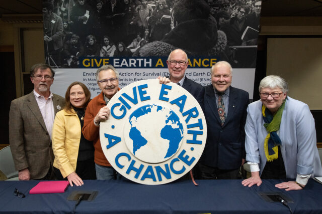 Photo of George Koling, Elizabeth Grant Kingwill, Doug Scott, David Allan, Arthur Hanson and Barbara Alexander with the emblem from the original 1970 Teach-In on the Environment.