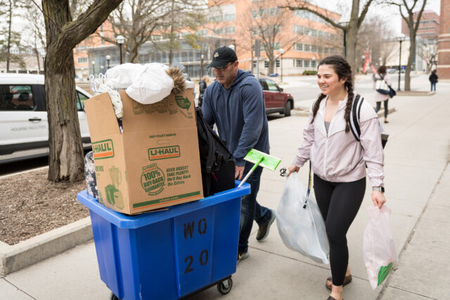 Photo of LSA undergraduate Abigail Yant and her father, Greg, moving back to Indiana.