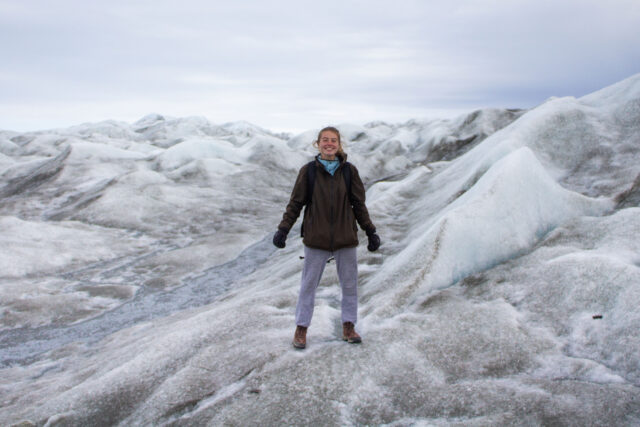Abigail Meyer, a graduating computer science engineering student, is pictured atop Russell Glacier in Greenland Ice Sheet. (Photo by Marc Koerschner)