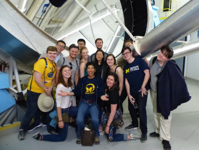Sally Oey (center front), professor of astronomy, with members of her 2017 Astro 461 class at the MMT telescope in Arizona. (Photo courtesy of Sally Oey)