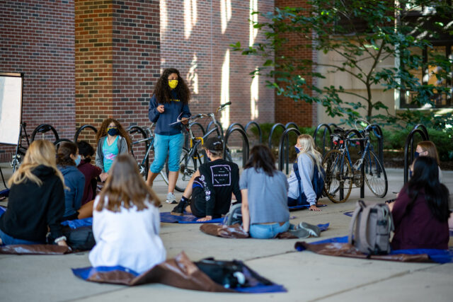 Photo of Alisse Portnoy, associate professor of English language and literature, teaches her English 140 class outside Shapiro Undergraduate Library.