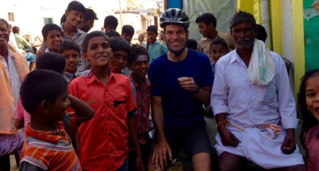 Stefan Koehler, associate director of licensing for U-M Tech Transfer, poses with children he met while riding his bicycle in India. (Photo courtesy of Stefan Koehler)