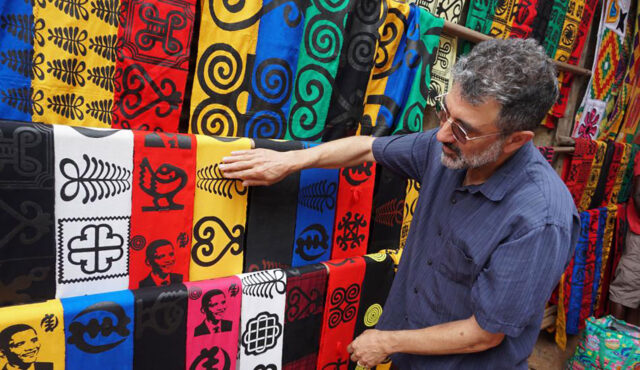 """Ron Eglash, a professor at the School of Information and Penny W. Stamps School of Art and Design, discusses fractal patterns on African textiles during the filming of """"Enslaved."""" (Photo courtesy Ron Eglash)"""