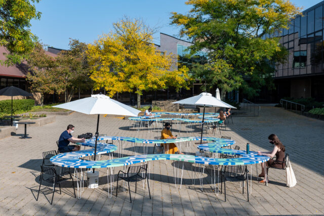 The tables fit together to provide clover-shaped work spaces at the Art and Architecture Building's inner courtyard.