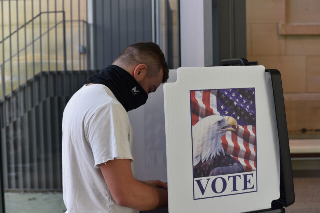 Riley Friedman, a junior at the School of Kinesiology, is a first-time voter. He cast his ballot after registering at the Ann Arbor City Clerk's satellite office in the U-M Museum of Art. (Photo by Fernanda Pires, Michigan News)