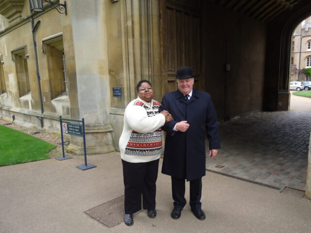 """Monica Adams, head of user services at UM-Dearborn's Mardigian Library, poses with a security guard at Trinity College Library in Cambridge, England, in 2013. Parts of the """"Harry Potter"""" movies were filmed in the library. (Photo courtesy of Monica Adams)"""