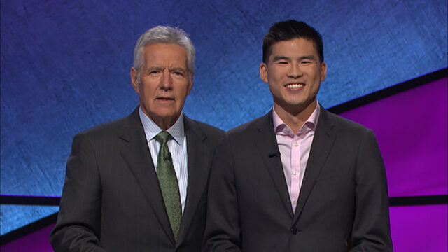 "Ian Shin, assistant professor of history and American culture in LSA, is shown with longtime ""Jeopardy!"" host Alex Trebek in 2017 when he appeared on the show and finished second."