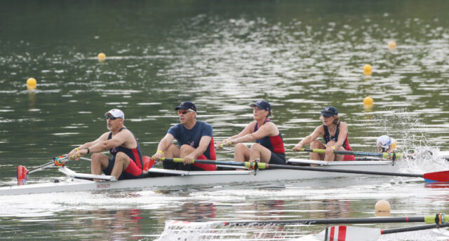 Mike Psarouthakis, second from left, and his wife, Lisa, second from right, compete in a co-ed race for the Ann Arbor Rowing Club. Psarouthakis, director of the U-M Tech Transfer Venture Center and managing director of the Accelerate Blue Fund, and his entire family participate in the sport of rowing. (Photo by Sport Graphics Inc.)