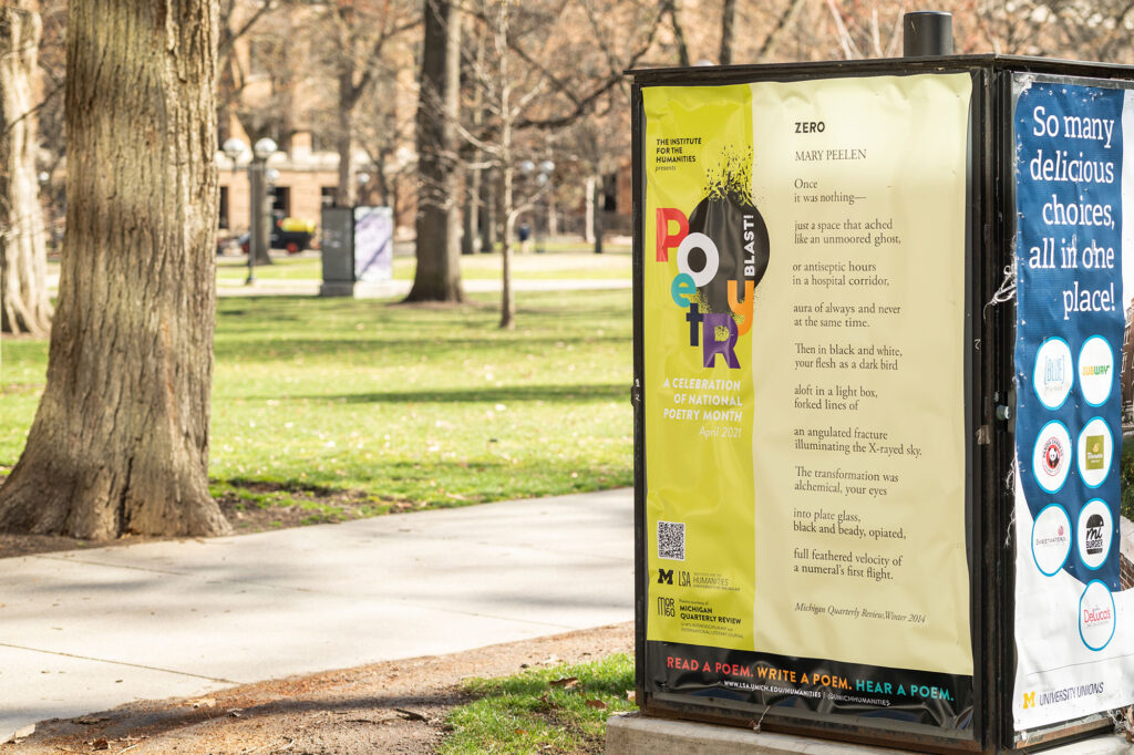 "Photo of a display on the Central Campus Diag that is one of more than 30 ""pop-up poems"" around campus and downtown Ann Arbor that are part of the monthlong ""Poetry Blast"" exhibition."