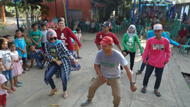 Rebecca Selin (back row, left), a graduate student in the Center for World Performance Studies, dances while on a research trip in Indonesia during the summer of 2018. (Photo courtesy of the Center for World Performance Studies)
