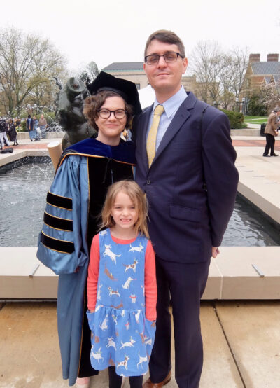 Kate Wroblewski is shown with her husband, Chad Weeks, and their daughter, Zofia, at Ingalls Mall during Rackham Graduate School commencement exercises in 2018. Wroblewski is a lecturer III in history in LSA and assistant director of undergraduate studies. (Photo courtesy of Kate Wroblewski)