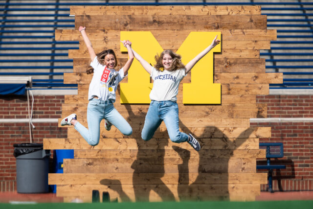 Photo of graduates jumping during Big House photo session