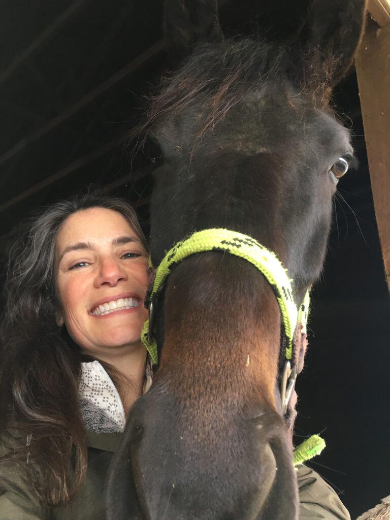 Margaret Wooldridge poses with one of her horses, Cleopatra. (Photo courtesy of Margaret Wooldridge)