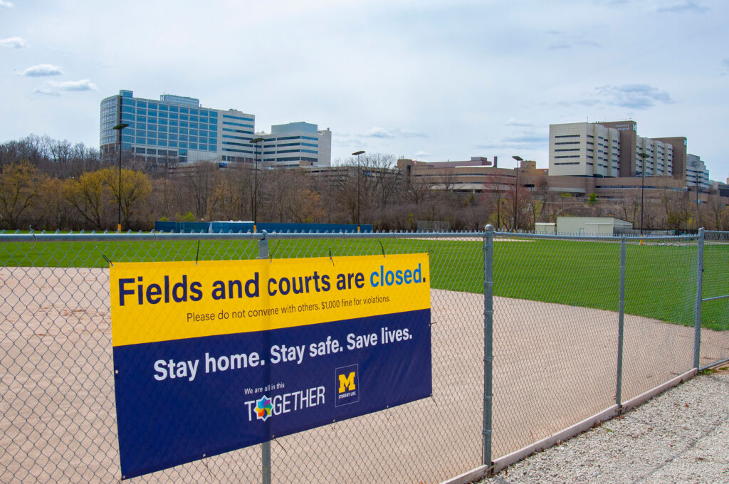 A sign alerts visitors fields and courts are closed April 27, 2020. (Photo by Henry Hedly, Michigan Medicine)