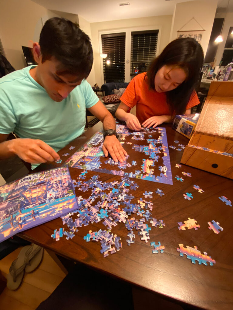 Students Rishabh Nayak, left, and Daphne Yao-Shin Wang work on a jigsaw puzzle to ward off boredom April 5, 2020. (Photo by Holly Reynolds)