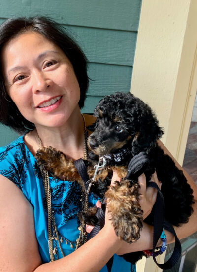 Christi-Anne Castro, associate professor of music and associate dean for faculty development in the School of Music, Theatre & Dance, holds Banjo, a poodle she and her family recently adopted. (Photo courtesy of Christi-Anne Castro)