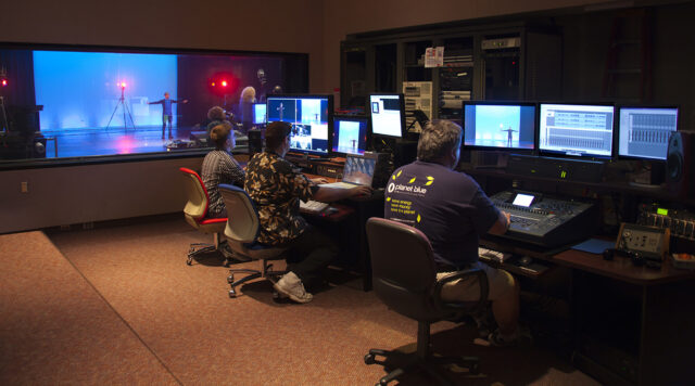 A motion capture demonstration is filmed in the Duderstadt Center Video Studio while staff monitor and record sound and video content from the video studio control room. (Photo courtesy of Duderstadt Center staff)
