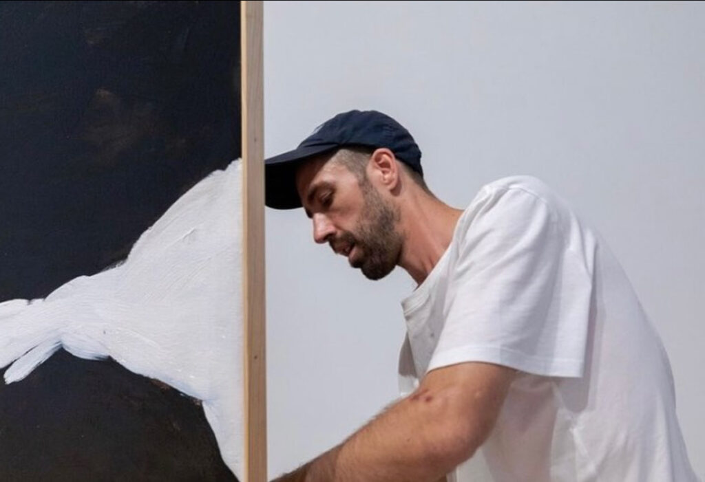 David Flaugher helps install a piece of artwork at the Eli & Edyth Broad Art Museum at Michigan State University as part of his first solo exhibition. (Photo courtesy of David Flaugher & Broad Art Museum)