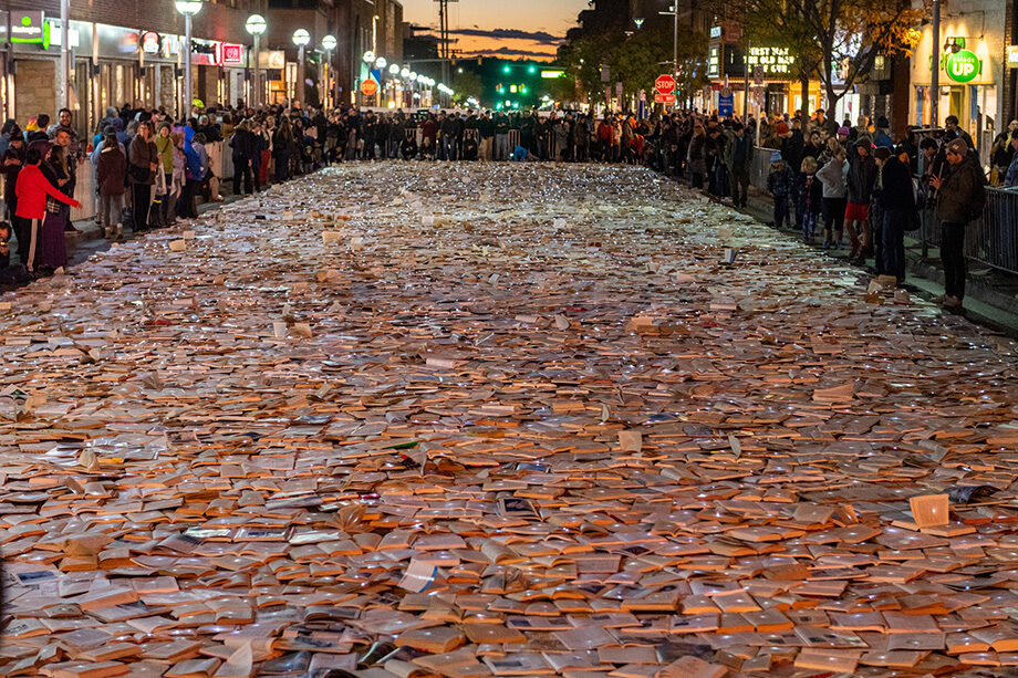"""Photo of Liberty Street """"paved"""" with LED-lit books"""