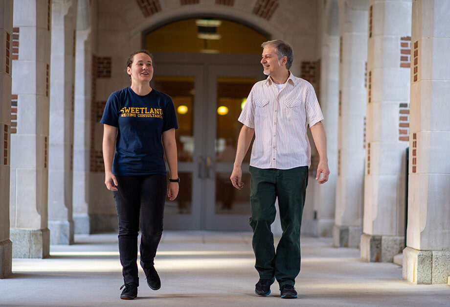 Photo of student Anna Horton walking with LSA lecturer Louis Cicciarelli