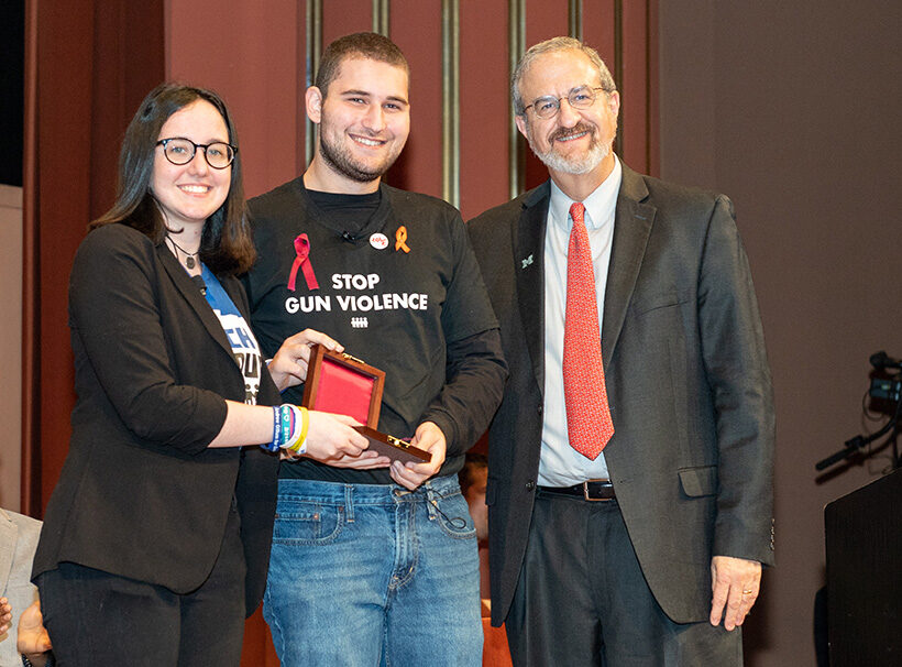 Photo of President Schlissel presenting the Wallenberg Medal to Sofie Whitney and Alex Wind of March For Our Lives