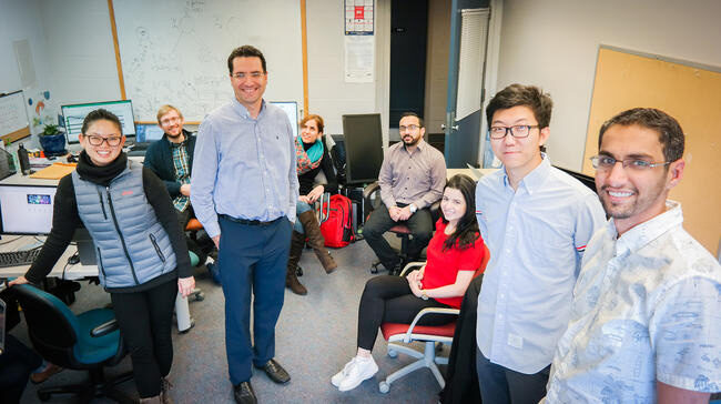 Photo of UM-Dearborn Associate Professor Marouane Kessentini, third from left, with his team of student researchers.