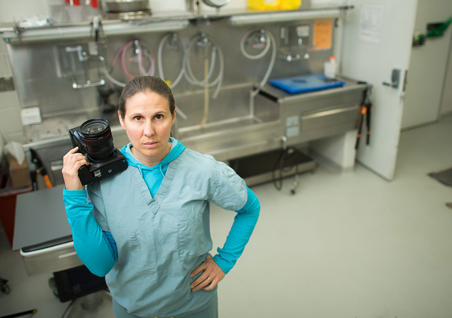 Photo of Lisa Belanger Neal with her camera in a lab