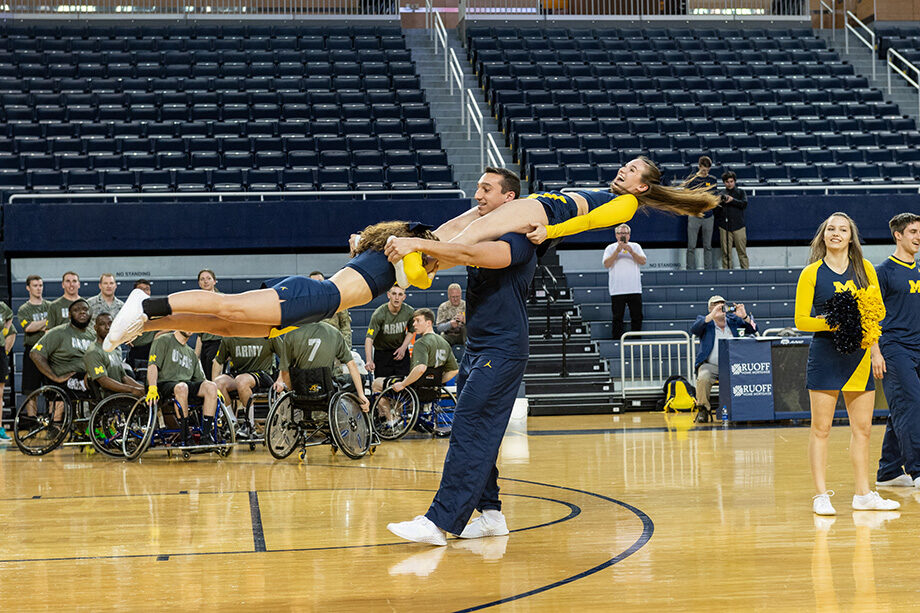 Photo of cheerleaders at wheelchair basketball game