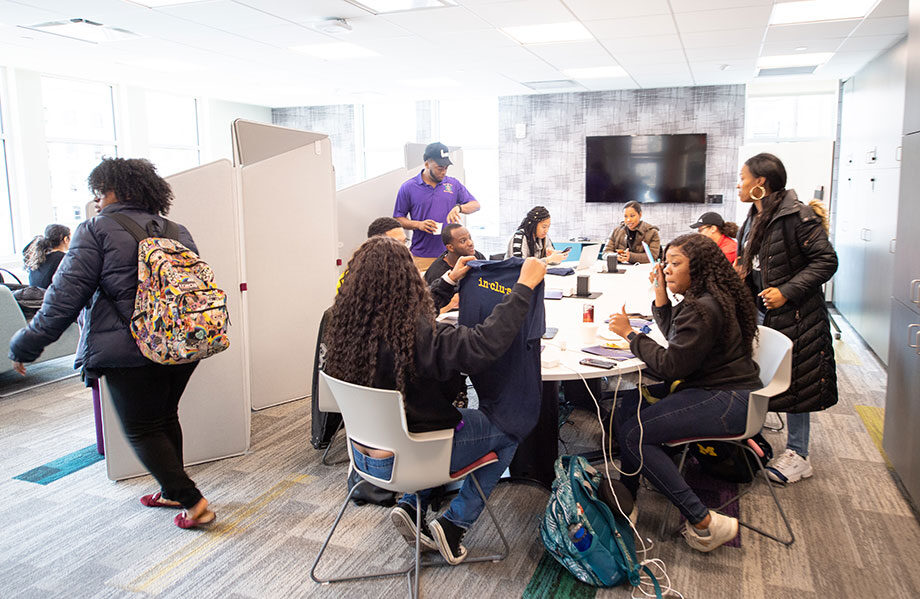 Photo of students in a workspace
