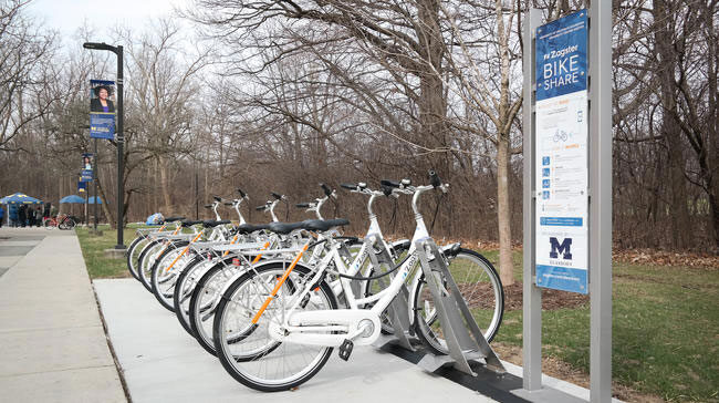 Photos of bikes at a bike-sharing station at UM-Dearborn