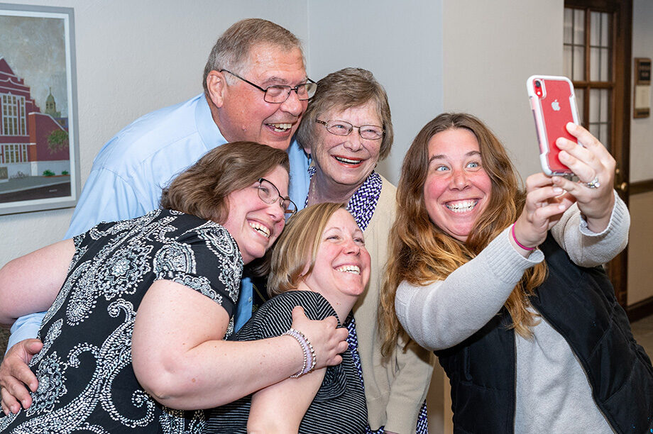 Photo of family taking a selfie at the College of Pharmacy ceremony