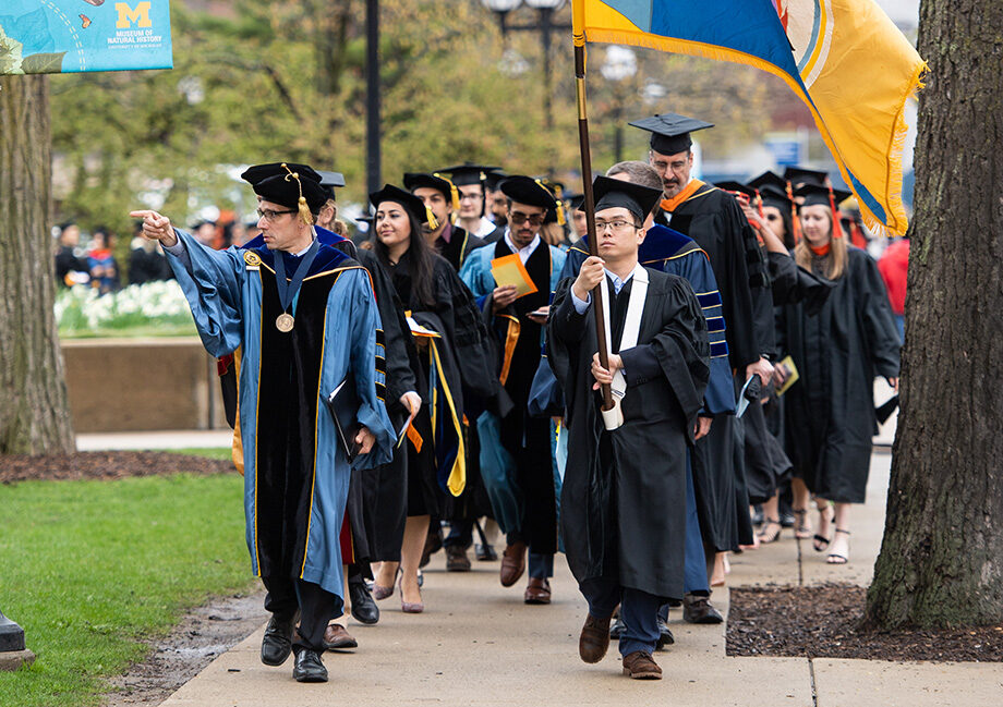 Photo of graduate procession from Rackham to Hill