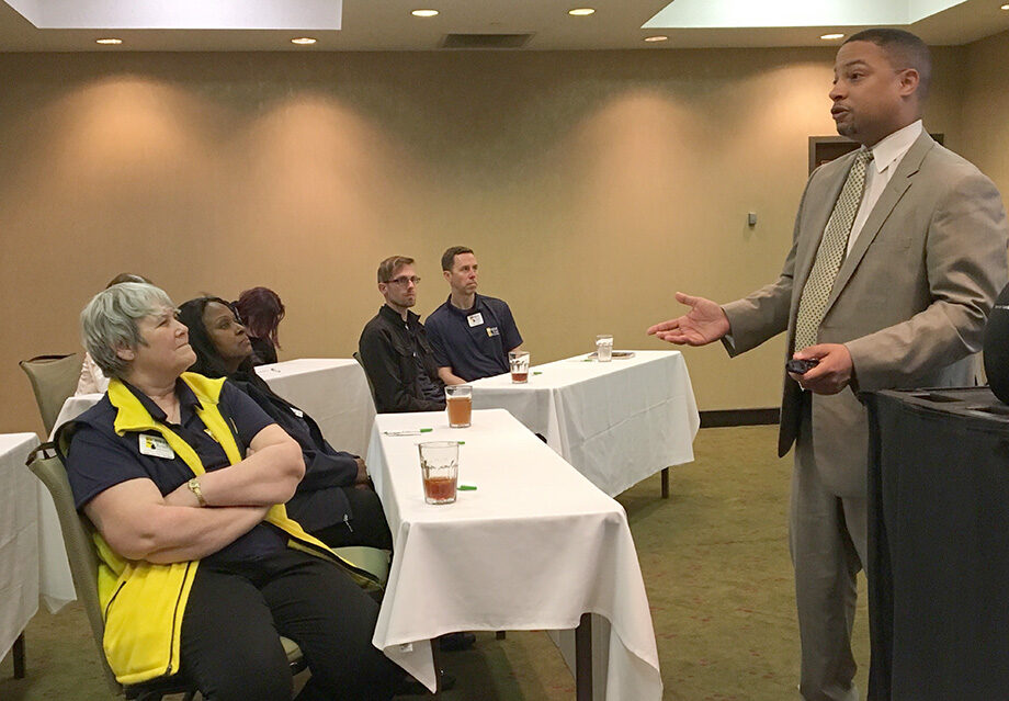 Photo of Mel Atkins II,executive director of community and student affairs for Grand Rapids Public Schools, talking with the Road Scholars