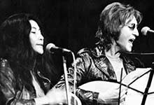 "Yoko Ono and John Lennon perform in 1971 during a ""Free John Now"" rally at Crisler Arena"